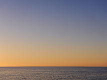 Crepúsculo sobre o mar em Córsega Fotos de Stock Royalty Free