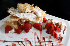 Crepe. With strawberry and ice cream on the dish Royalty Free Stock Image