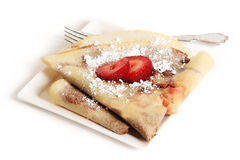 Crepe. Authentic French gourmet crepe with chocolate filling and strawberry garnish on top royalty free stock photo