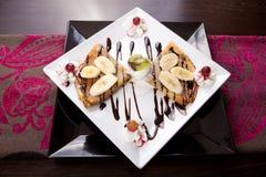 Crepe. Banana pancake Crepe with cream and chocolate sauce stock photo
