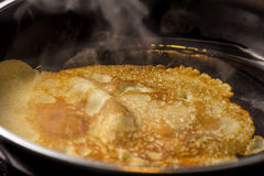 Crepe baking in pan Stock Photography