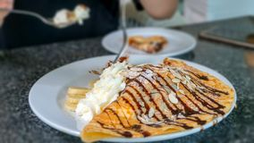 Crepe with banana and chocolate royalty free stock photography