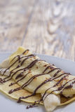 Crepe with banana and chocolate sauce Royalty Free Stock Photos