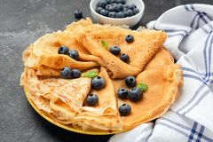 Crepe or blini on plate. With fresh blueberries stock photos
