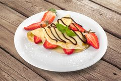 Crepe. Breakfast sweet french cake closeup rolled stock photo