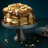 Crepe cake with chocolate and nuts. Crepe cake with custard cream,chocolate topping and nuts royalty free stock photos