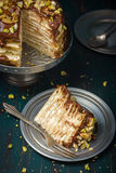 Crepe cake with chocolate and nuts Stock Image