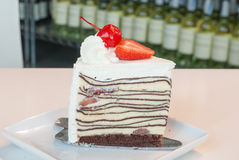 Crepe cake. Chocolate Crepe cake with strawberry stock photo