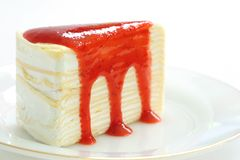 Crepe cake. With strawberry sauce Stock Images