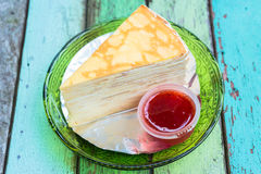 Crepe cake with the strawberry sauce Stock Image
