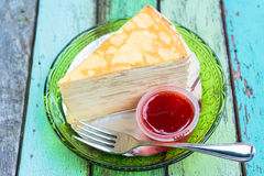 Crepe cake with the strawberry sauce Stock Photography