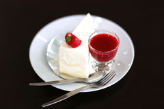 Crepe cake with strawberry sauce on black table. Crepe cake with strawberry sauce Stock Photo