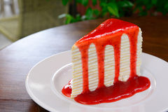 Crepe cake with strawberry sauce Stock Photography