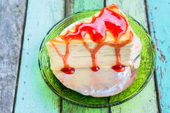 Crepe cake with strawberry sauce Royalty Free Stock Photo