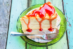 Crepe cake with strawberry sauce Stock Photos