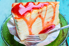 Crepe cake with strawberry sauce Stock Images