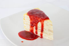 Crepe Cake with strawberry source. On dish Stock Image