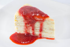 Crepe Cake with strawberry source. On dish Royalty Free Stock Photography