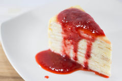 Crepe Cake with strawberry source. On dish Stock Images