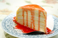 Crepe cake topped with strawberry jam Royalty Free Stock Images