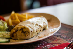 Crepe with cheese, lettuce and fries. Royalty Free Stock Photography