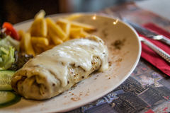 Crepe with cheese, lettuce and fries. Royalty Free Stock Photos