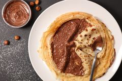 Crepe with chocolate. Spread, above royalty free stock photo