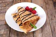 Crepe. With chocolate and raspberry royalty free stock images