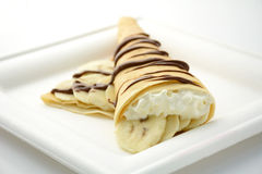 Crepe cone filled with banana slices and whipped cream Stock Photography