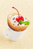 Crepe with cream. Crepe with whipped cream and cream cheese in coffee cup, selective focus Royalty Free Stock Image