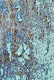 Crepe di pittura su un fondo del metallo Fotografie Stock