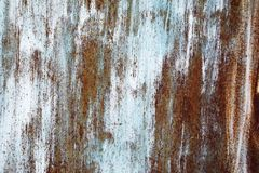 Crepe di pittura su un fondo del metallo Immagini Stock Libere da Diritti