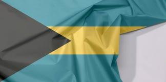 Crepe e vinco da bandeira da tela do Bahamas com espaço branco fotos de stock