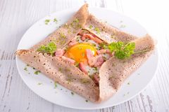 Crepe with egg and bacon. Cooked crepe with egg and bacon royalty free stock photos