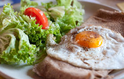 Crepe with egg. French pancake savoury with egg and salad garnish Stock Photography