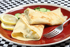 Crepe filled with chicken in sauce Stock Photography