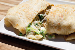 Crepe filled with vegetables and mixed salad. Close up of crepe filled with vegetables and mixed salad royalty free stock images