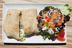 Crepe filled with vegetables and mixed salad Stock Photos