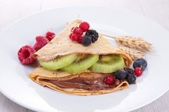Crepe with fruit and chocolate Stock Image