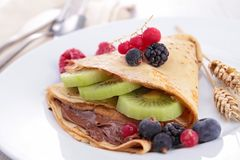 Crepe with fruit and chocolate Stock Images