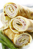 Crepe ham cheese. Rolled ham and cheese crepe with asparagus on a white background royalty free stock photography