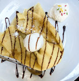 Crepe with ice cream. Crepe pancake with ice cream and chocolate sauce royalty free stock image
