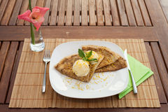 Crepe with ice cream on wood table Stock Images
