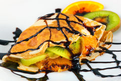 Crepe with kiwi and orange Stock Photos
