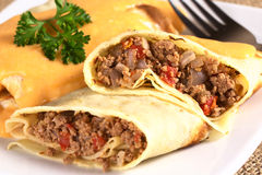 Crepe a la Hortobagy. Hungarian-style crepe called Hortobagyi Husos Palacsinta (Crepe a la Hortobagy) filled with a mix of meat, tomato and onion amd served with stock image