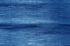 Crepe paper with blur effect in navy blue color. royalty free stock photos