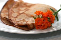 Crepe on the plate decorated with flowers royalty free stock image
