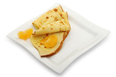 Crepe on a plate with mandarin royalty free stock photography