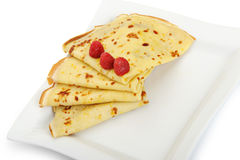 Crepe on a plate with a raspberry Stock Photo