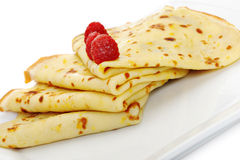 Crepe on a plate with a raspberry Stock Photos